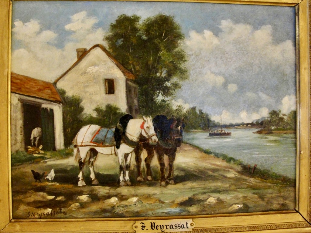 Two horses next to the river