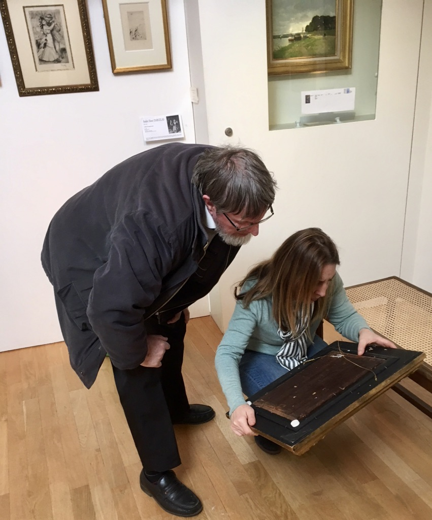 Checking the painting